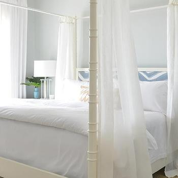 white faux bamboo canopy bed with limed oak mirrored nightstands