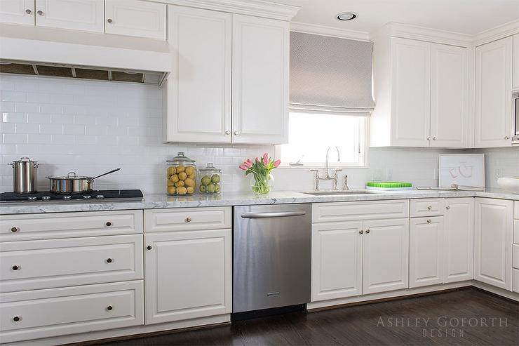 off white kitchen cabinets with white subway tiles - transitional