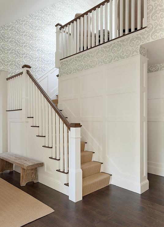 Staircase With Wainscoting And Gray Ikat Wallpaper