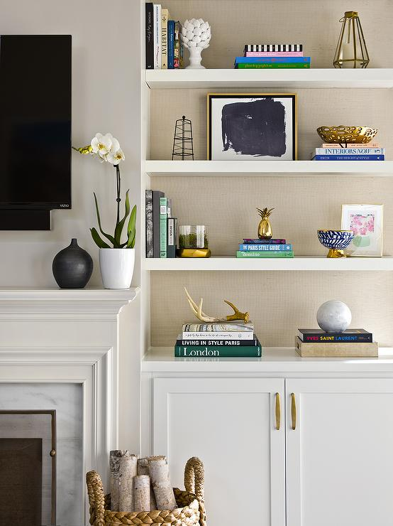 transitional living room is equipped built in styled white shelves
