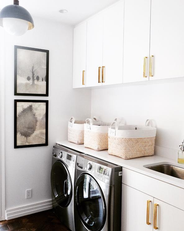 Laundry Room Stainless Steel Sink : white and gold laundry room features black framed stacked laundry room ...