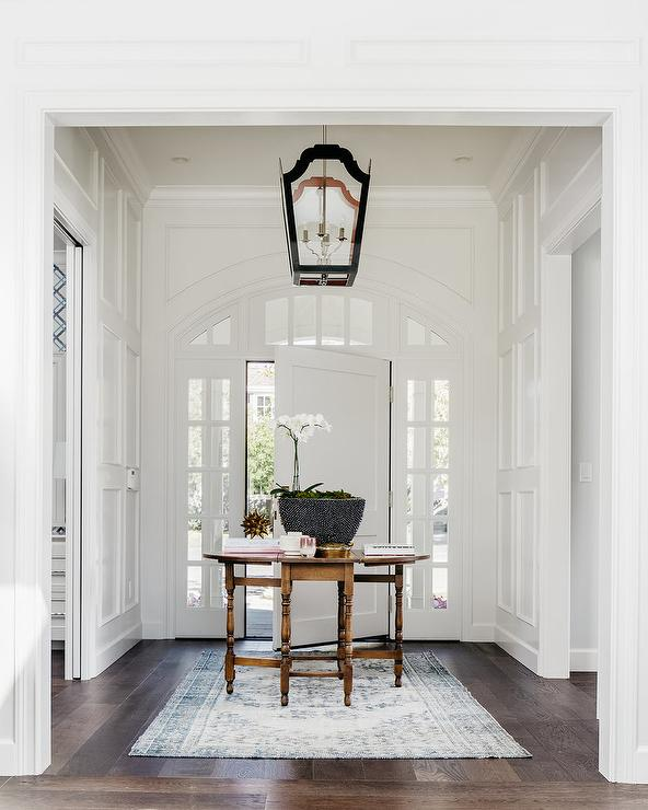 front door tableBlack Lantern Over Middle of The Foyer Table  Transitional