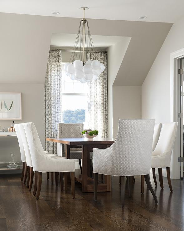 Coffee Stained Dining Table with White Upholstered Dining ...