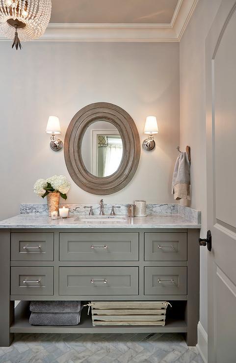 Mediterranean Style Bathroom With Oval Silver Mirror