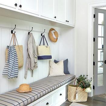 Long and narrow home office with gray bi fold doors for Mudroom office