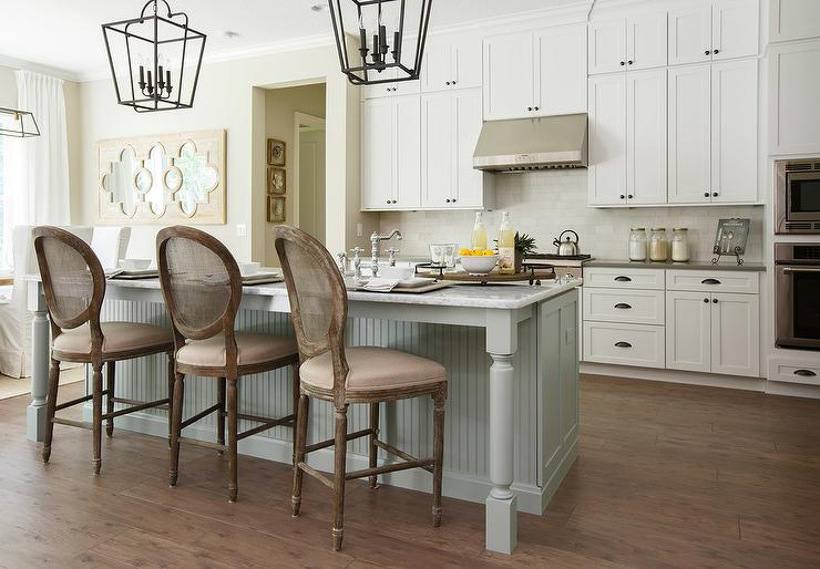 White Wainscoted Island With Purple Linen French Bar Stools