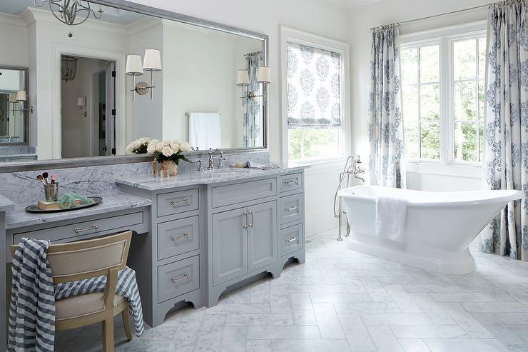 Gray Master Bathroom With White Marble Herringbone Floor