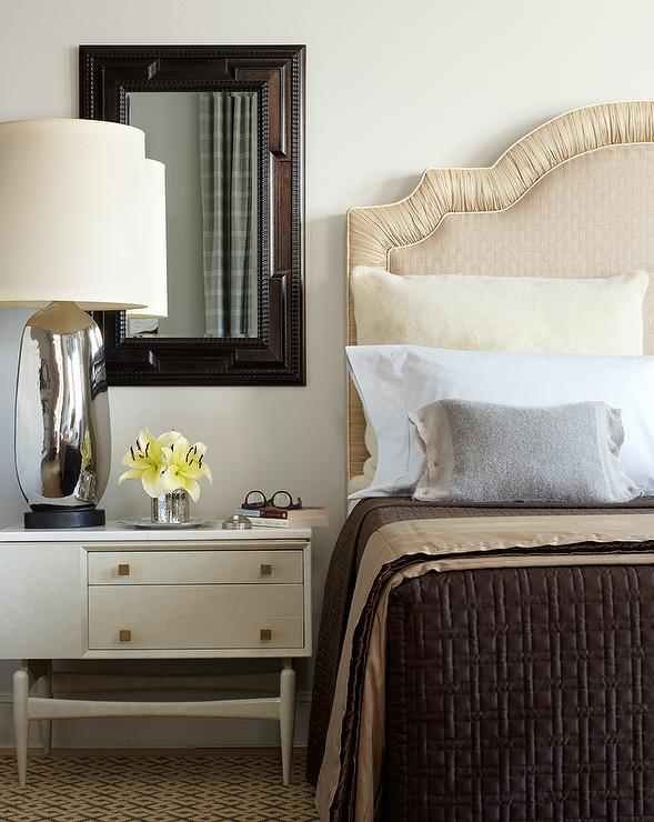 Cream curvy headboard with gray lamp transitional bedroom for Brown and cream bedroom