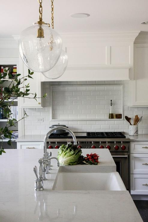 Beveled Subway Tiles with Cooktop Spice Niche - Transitional - Kitchen