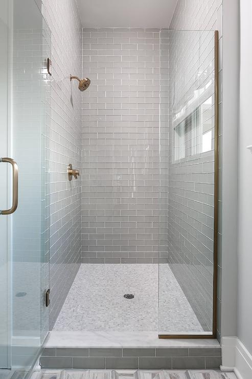 Walk In Shower with Gray Glass Subway Tiles and White Marble Grid Floor