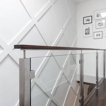 Glass Staircase Railing With Diamond Pattern Wainscoted Wall