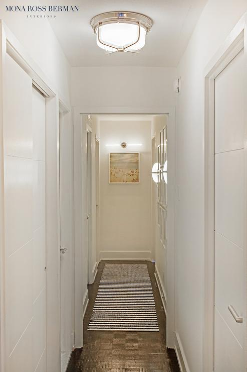 Long Hallway With Black And White Striped Runner