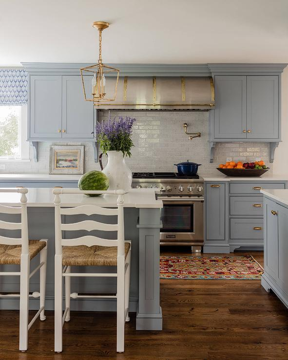 Blue gray kitchen cabinets with antique brass hardware for Blue gray kitchen cabinets