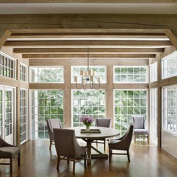 Elegant Dining Room Surrounded By Windows