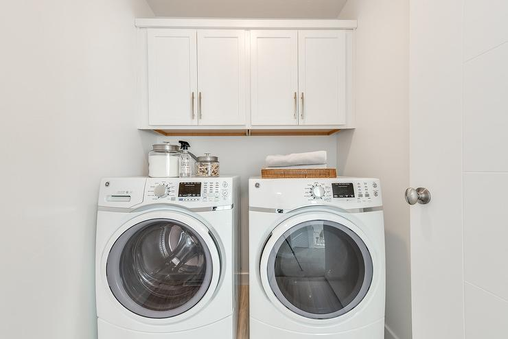 white laundry room with cabinets over washer and dryer Above Washer Cabinets