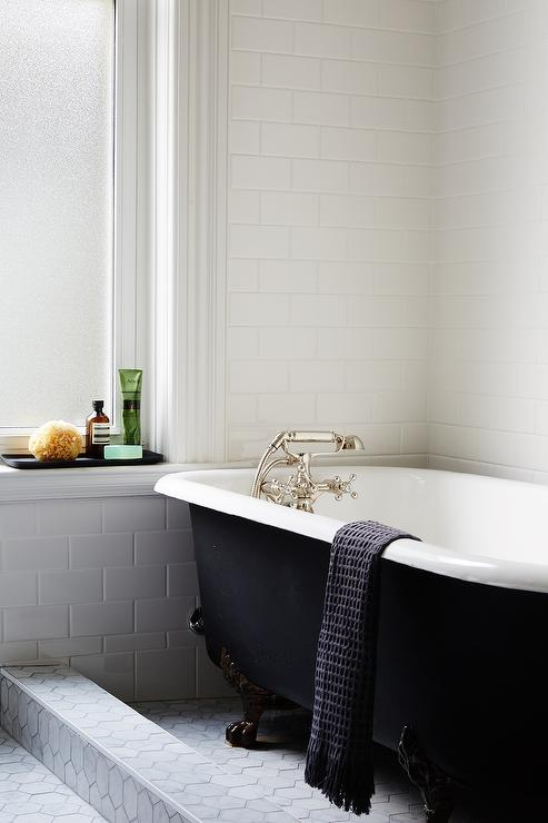 Black Clawfoot Tub With Marble Tiles Transitional Bathroom