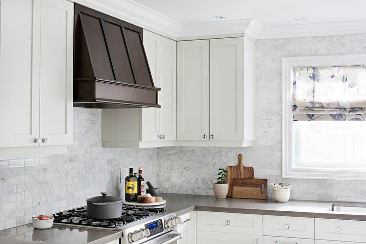 Steel and brass kitchen hood with white shaker cabinets for Vent hoods for kitchens