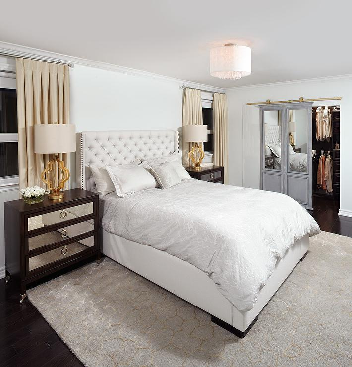 Beautifully Appointed Contemporary Bedroom Features Brown Mirrored  Nightstands Topped With Decoratoru0027s Lighting Gateway Collection Table Lamps  In Gold Leaf ...