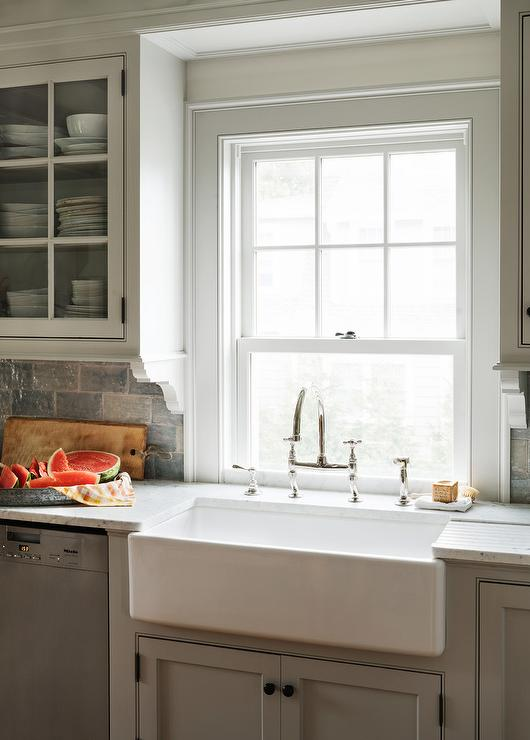light gray kitchen cabinets with farm sink - cottage - kitchen