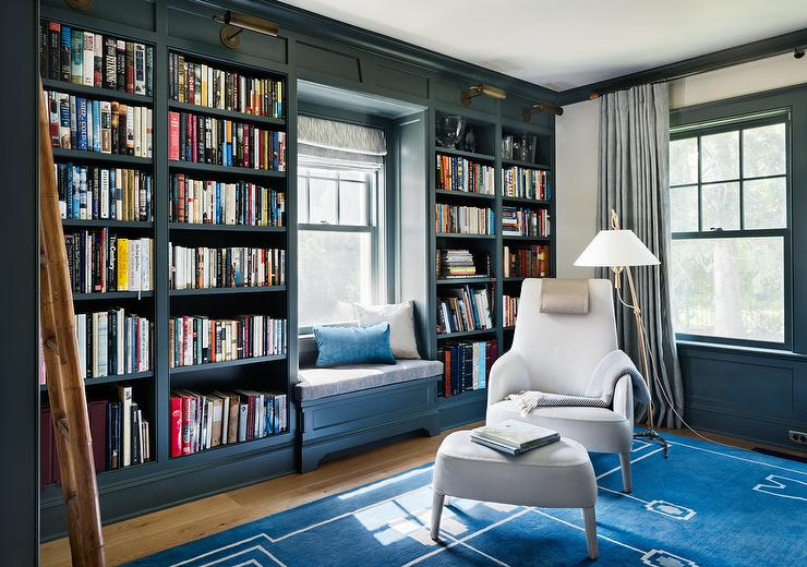 Blue Bookcase blue paneled den with dark blue built in bookcases - transitional