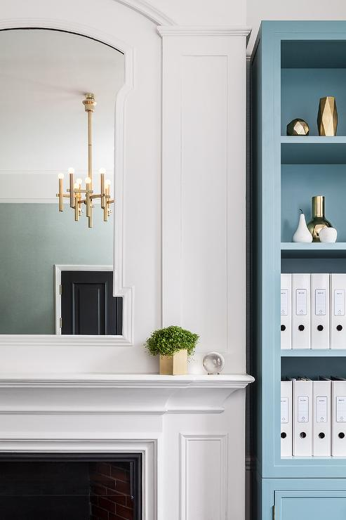 Blue Bookcase fireplace with blue bookcase - contemporary - entrance/foyer