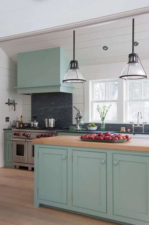 Light Blue Farmhouse Kitchen Features Cabinets Adorned With Knobs Paired Dark Gray Stone Countertops And Shiplap Backsplash