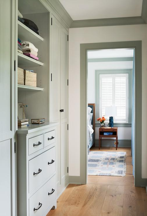 Long Walk In Closet With Gray Built Ins