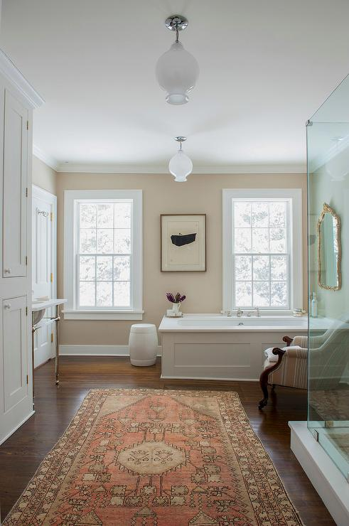 White and tan bathroom with orange wool rug transitional for Master bathroom rugs