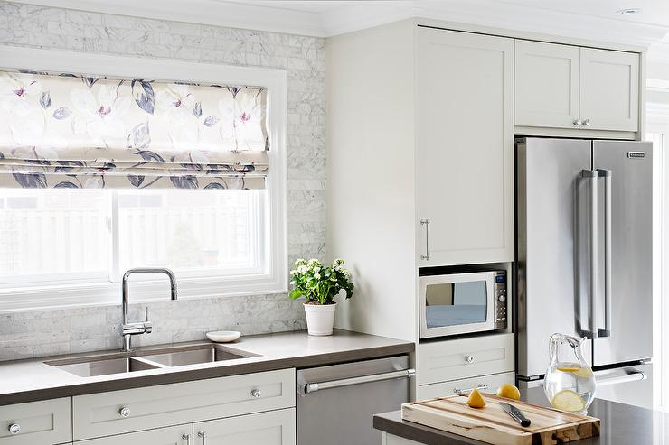 Off White Kitchen Backsplash off white kitchen cabinets with white subway tiles - transitional