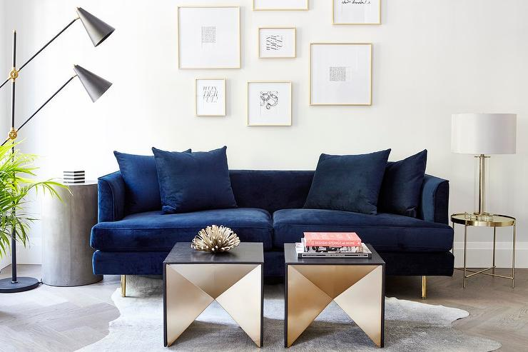 Blue Velvet Sofa On Brass Legs With White And Gray Cowhide Rug