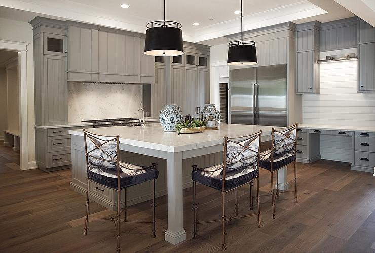 view full size. Expansive gray kitchen showcases a stunning large square  center island ...