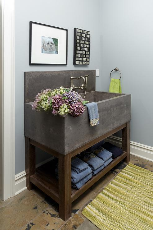Concrete Sink Vanity With White And Blue Wallpaper