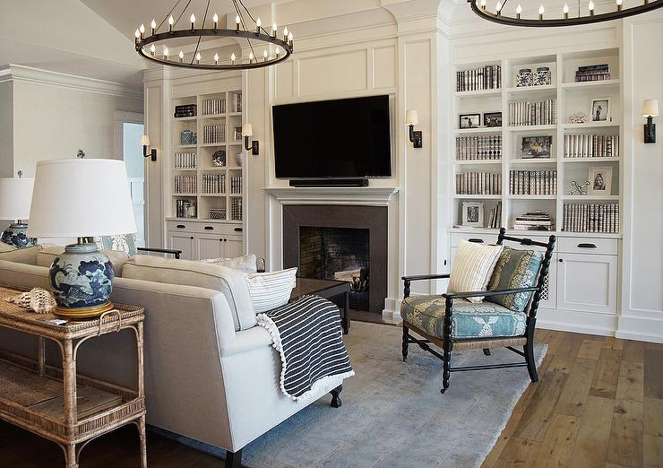 White Cottage Living Room With Picture Lights On Bookcase