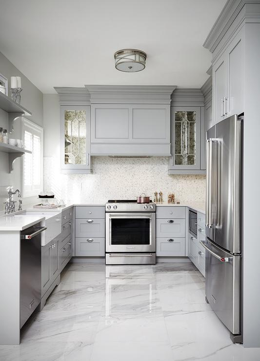 gray shaker kitchen cabinets with engineered white quartz On u shaped bedroom cupboards