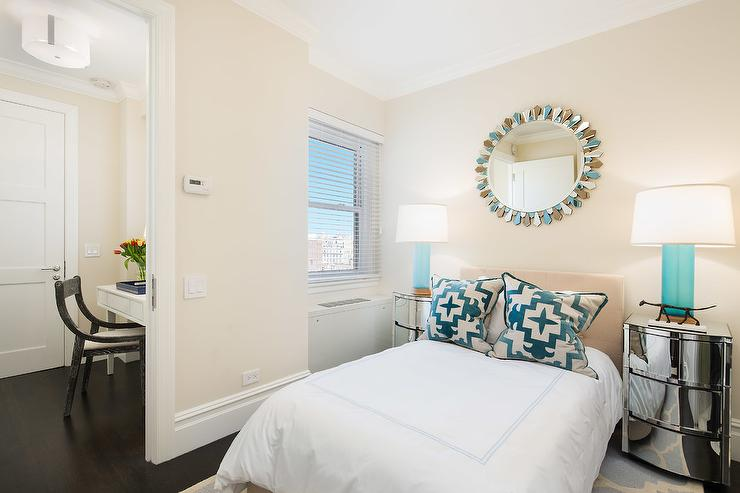 Cream And Blue Contemporary Bedroom Features A Blue Sunburst Mirror Fixed  To A Cream Wall Above A Tan Headboard Accenting A Bed Dressed In Blue  Border Hotel ...