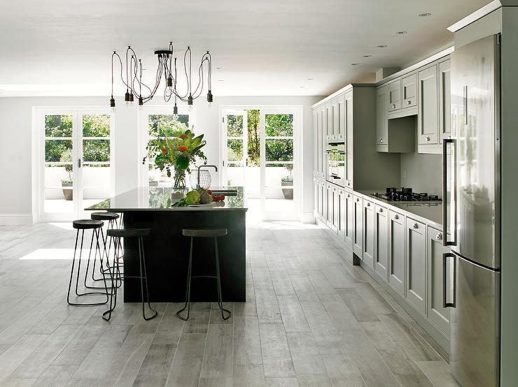 Light Gray Kitchen With Dark Grey Island Transitional Kitchen - Light grey kitchen cabinets with black island