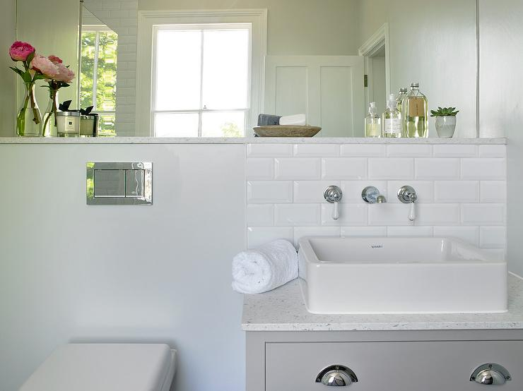 white beveled subway tiles with vintage style wall mount sink