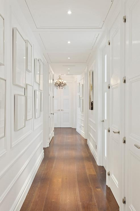 White Hallway With Gray Picture Frames Transitional