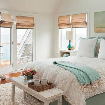 beige and blue bedroom features a light blue canvas art piece placed