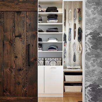 Walk In Closet With Plank Barn Door On Rails