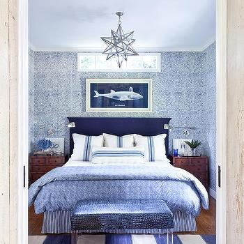 Blue Cottage Bedroom With Brown Bamboo Nightstands
