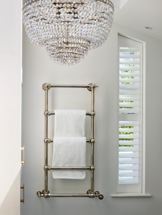 wall mount towel warmer. Wall Mounted Towel Warmer Next To Plantation Shutters On Angled Window Mount