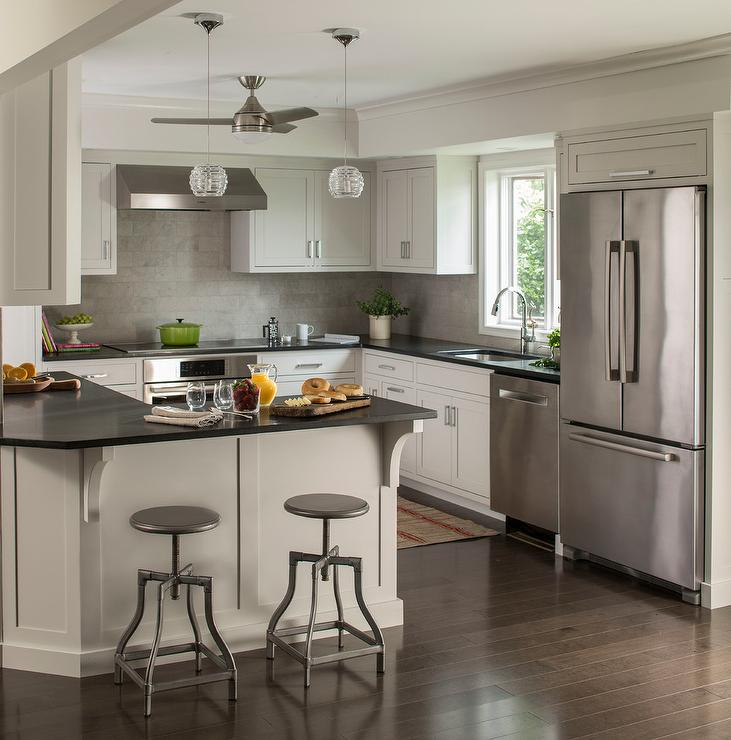 Quartz Tiles For Kitchen Countertops : ... with black quartz countertops and a linear gray tile backsplash