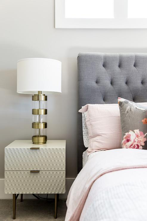 Gray Tufted Headboard With Pink Duvet Cover And Shams