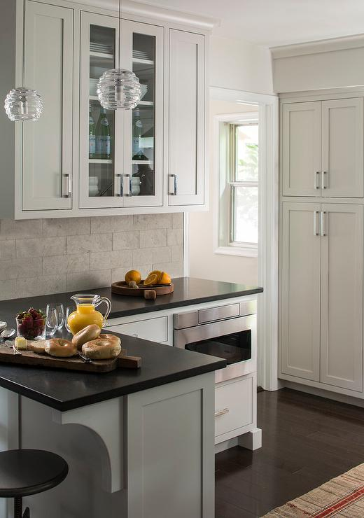 View Full Size Chic Kitchen Features Extra Light Gray Cabinets Paired With Black Quartz Countertops