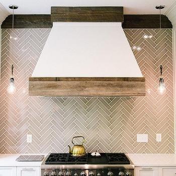 White Cabinets with Gray Glass Herringbone Tiles & Kitchen Hood Hanging Light Pendants Design Ideas