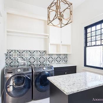 blue laundry room with chevron pattern porcelain floor