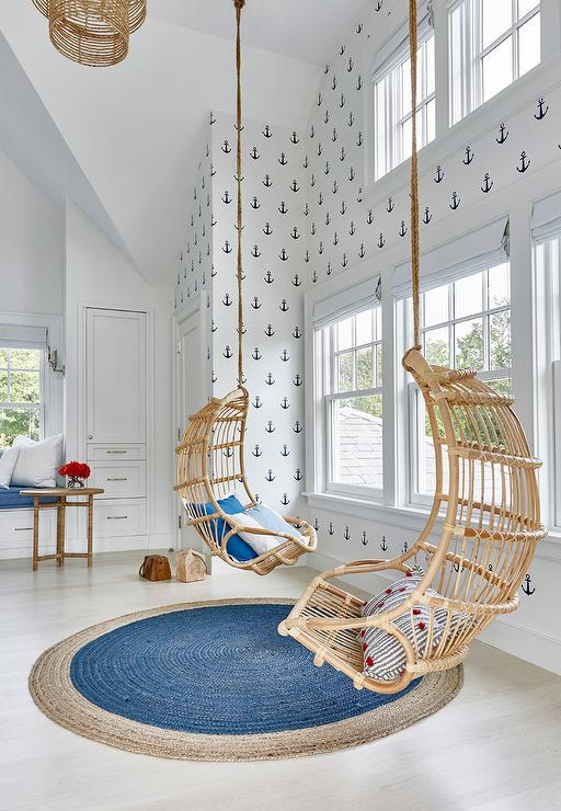 Nautical style boyu0027s bedroom boasts an accent wall clad in white and navy blue anchor wallpaper alongside a pair of Twou0027s Company Hanging Rattan Chair ... & Boy Room Hanging Chair Design Ideas