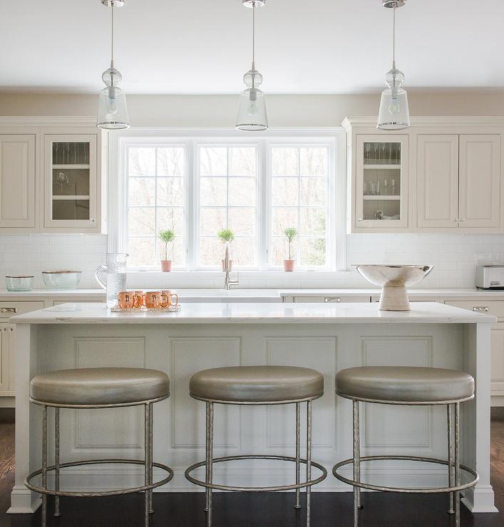 White Kitchen With Taupe Oval Leather Barstools
