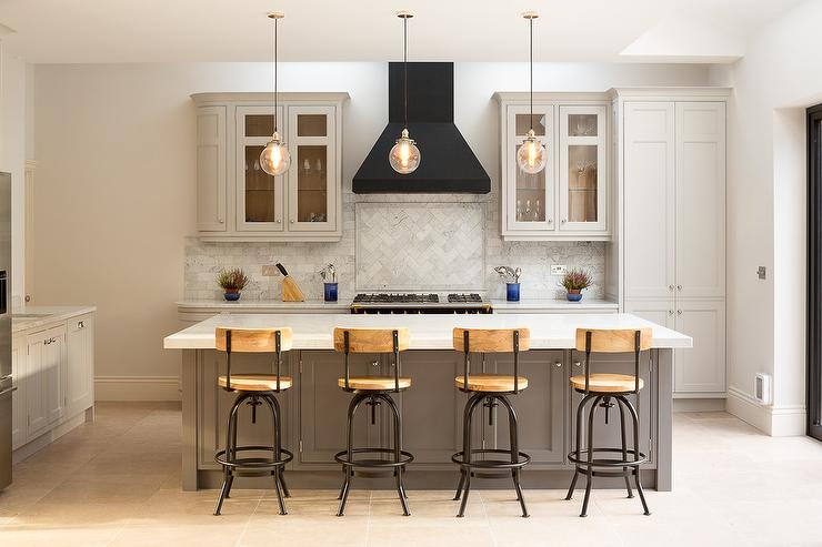 Light Gray Kitchen With Black French Vent Hood